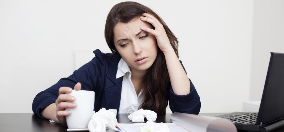 woman at work not feeling well